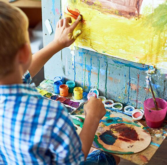 Little Boy In Art Therapy YEFUVA2 580x574